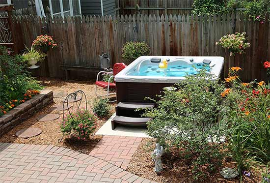 Hot tub with garden landscaping