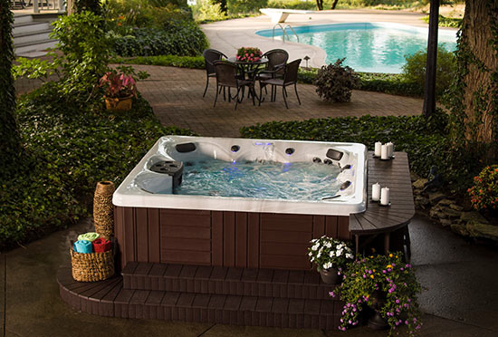 Outdoor hot tub on stamped concrete patio
