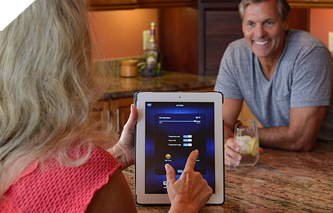 remotely adjust the hot tub temperature using an app on her tablet
