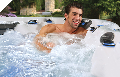 Michael Phelps smiling in hot tub
