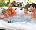 Family spending time in a hot tub