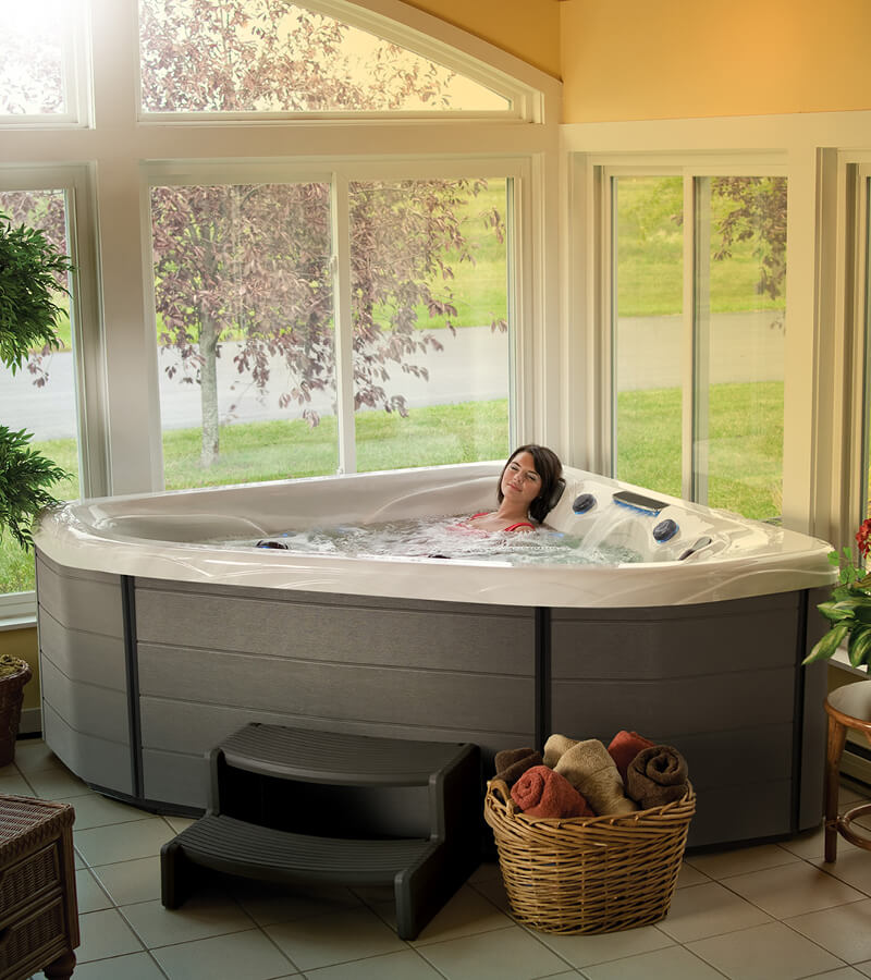 A corner two-person hot tub completes this sunroom design