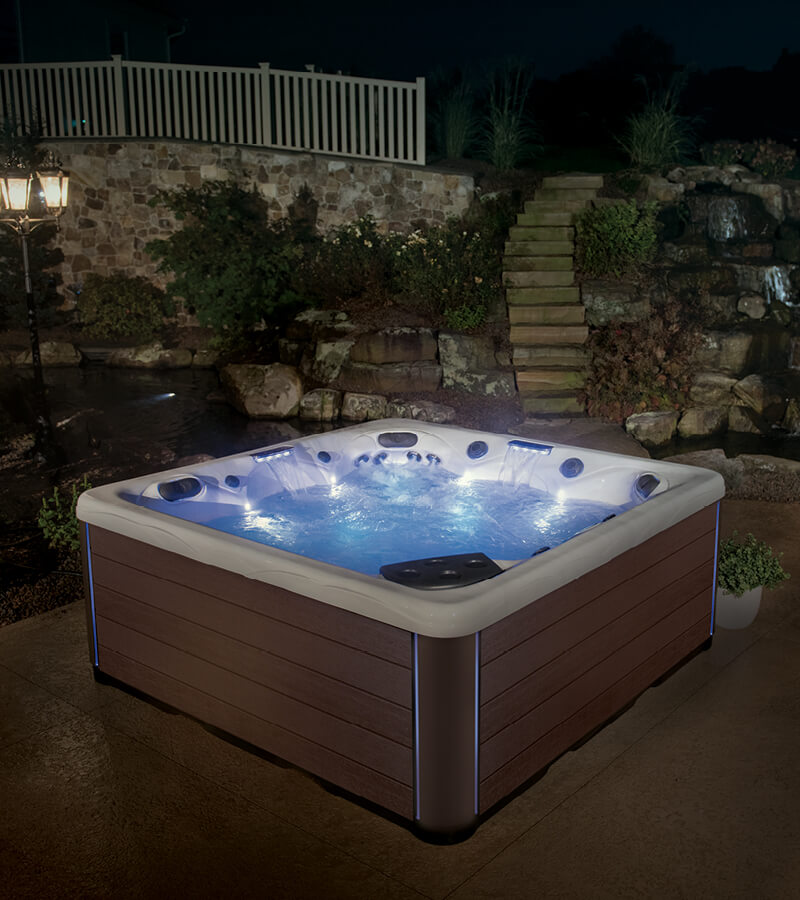 Colorful LED lights on the hot tub add ambiance to the backyard patio